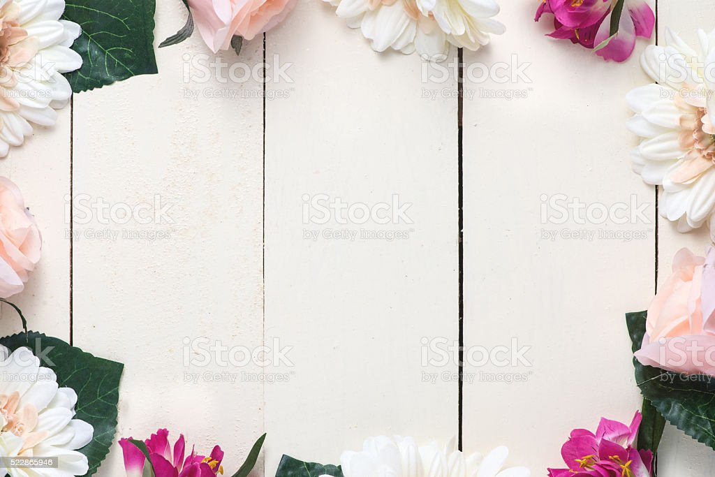 Frame of spring glowers arranged on white wooden background stock photo