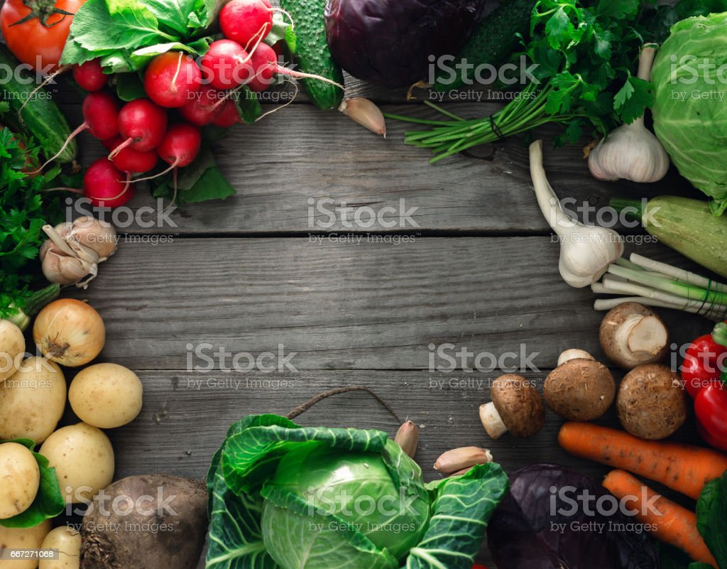 Frame of various vegetables on a wooden table stock photo