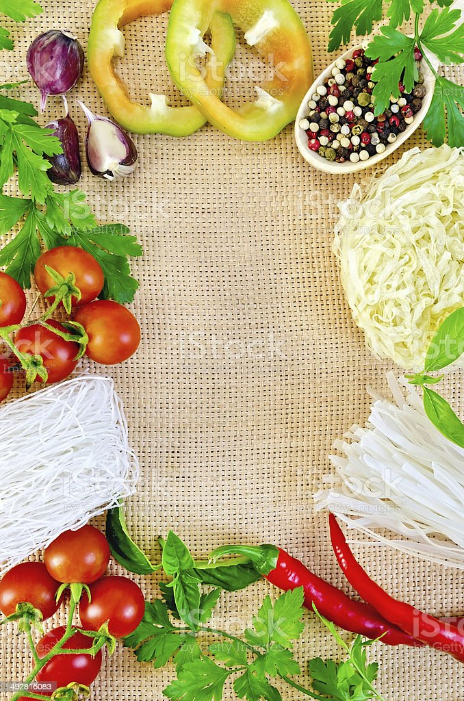 Frame of vegetables and funchozy on sacking royalty-free stock photo