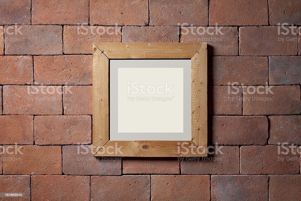 Frame on a brick wall royalty-free stock photo