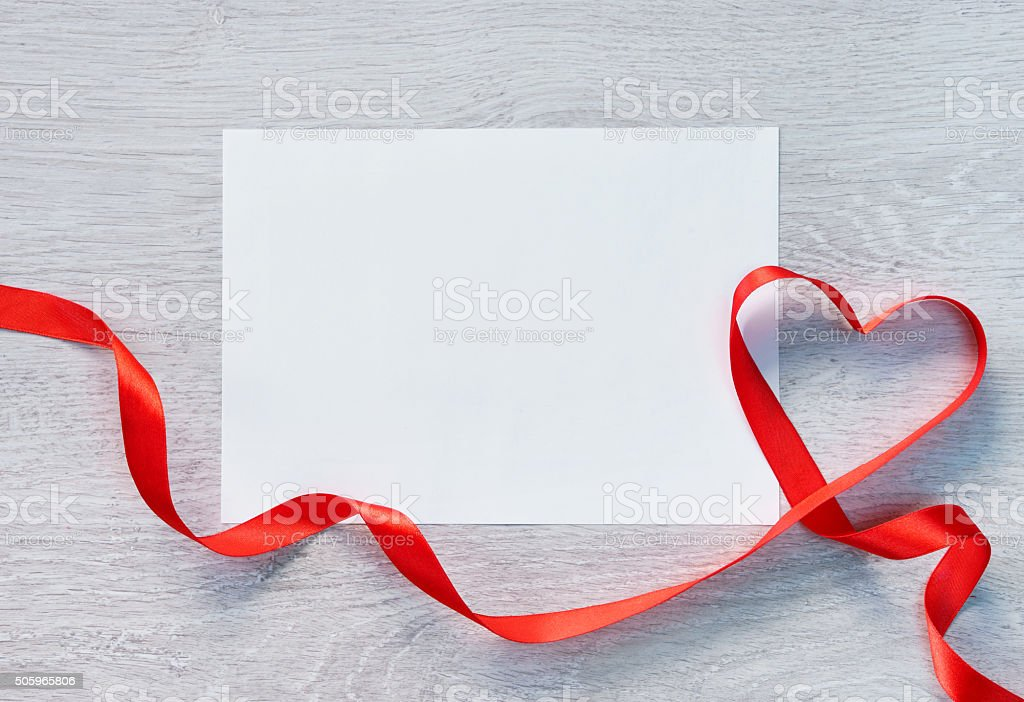 Frame or gift card with valentines heart shaped ribbon stock photo