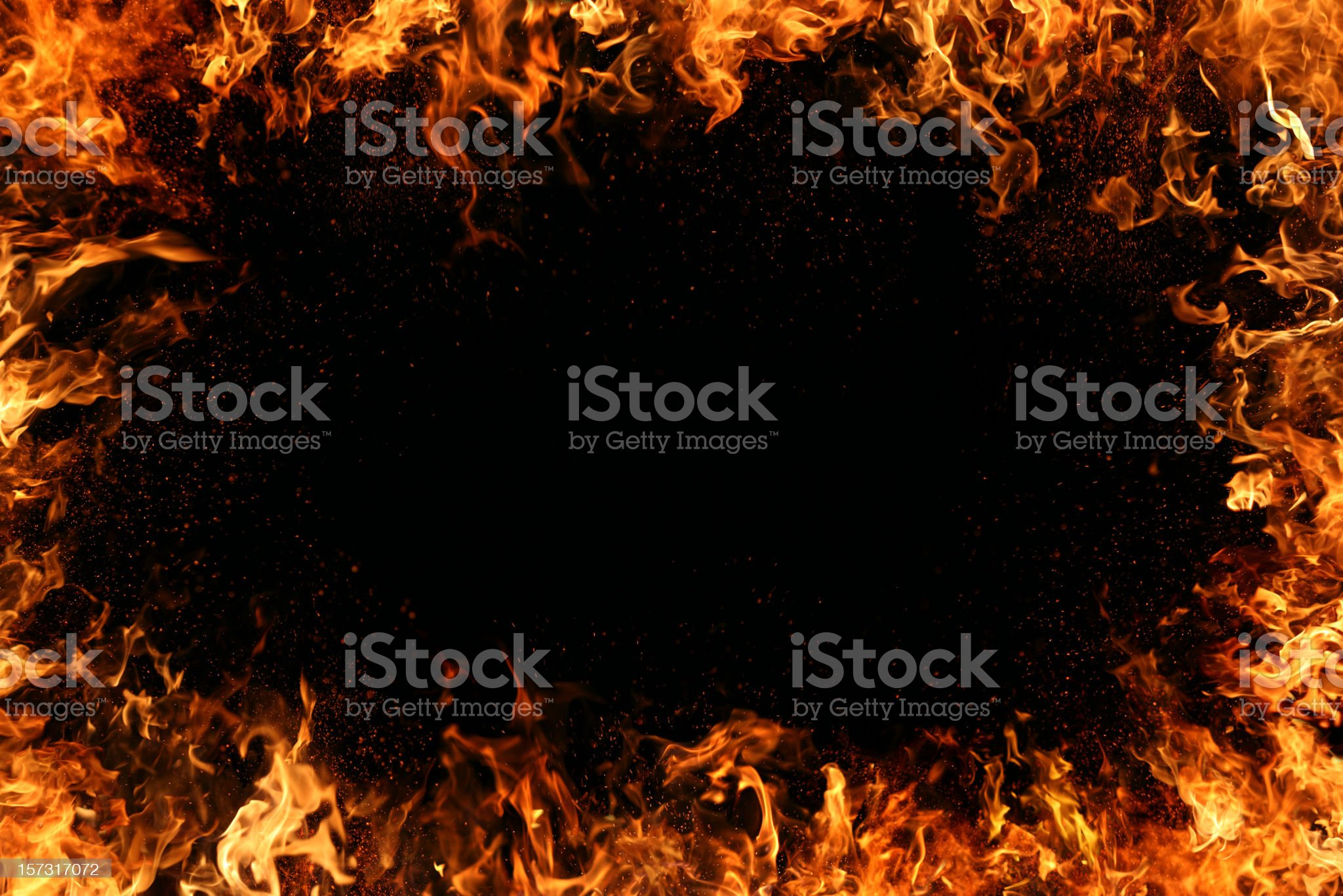 A frame template of realistic flames on a black background royalty-free stock photo