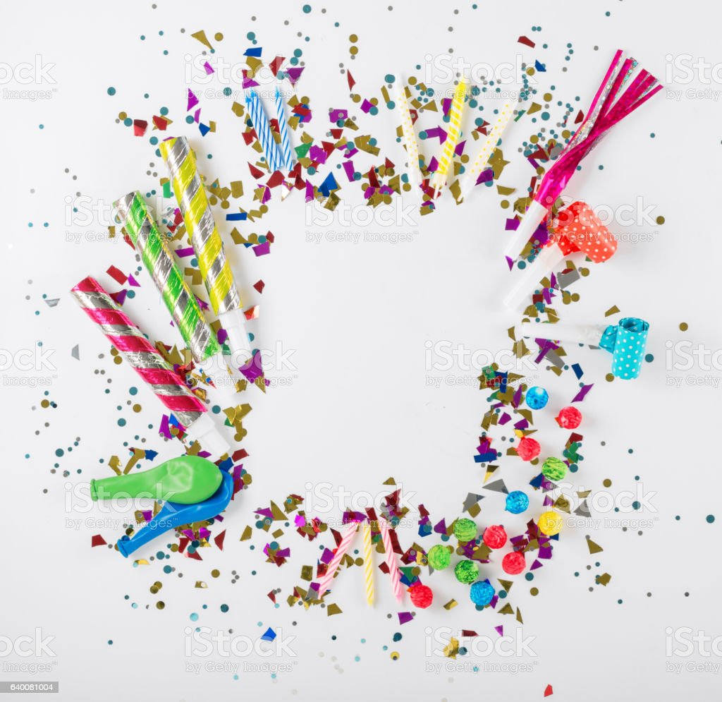 Frame with confetti, balloons, noisemakers and decoration on whi stock photo
