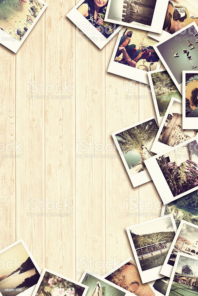 Frame with old paper and photos on wooden background. stock photo