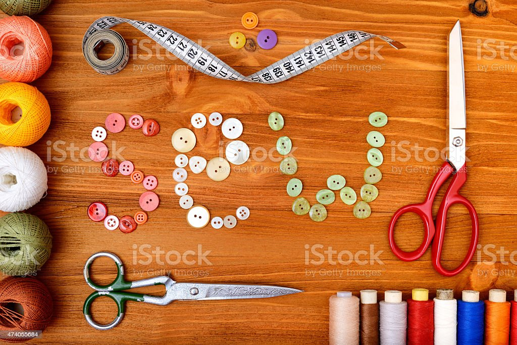 Frame with sewing tools and accesories on wooden background stock photo