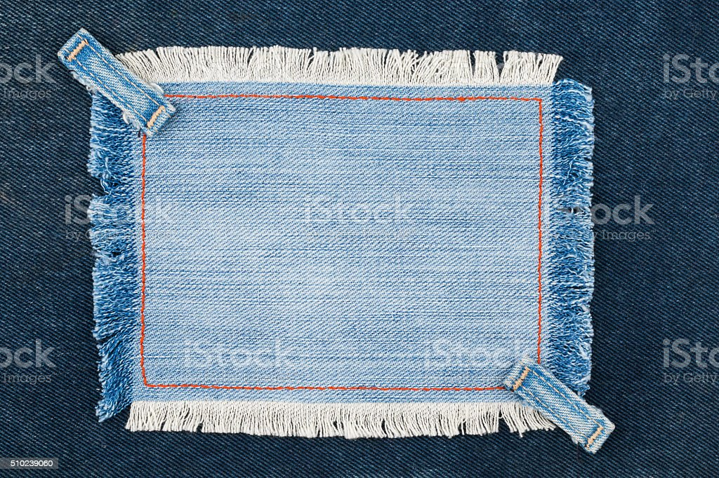 Frame with two straps jeans, lies on the dark denim stock photo