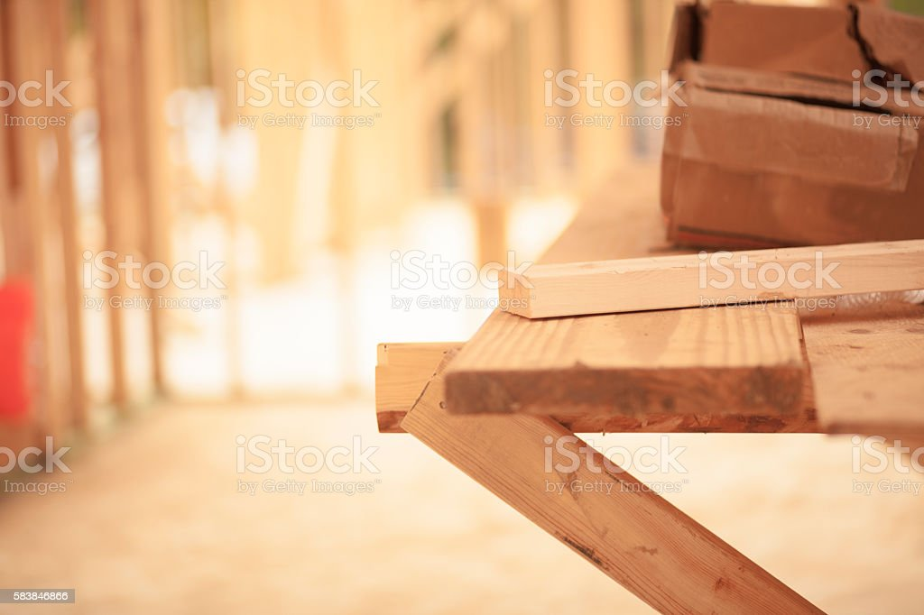 Framed building at empty construction job site. stock photo