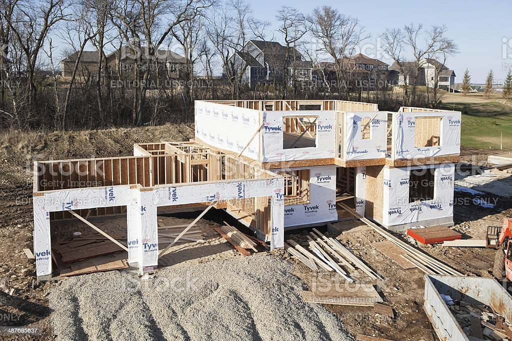 Framed New House Construction Site with Tyvek HomeWrap stock photo