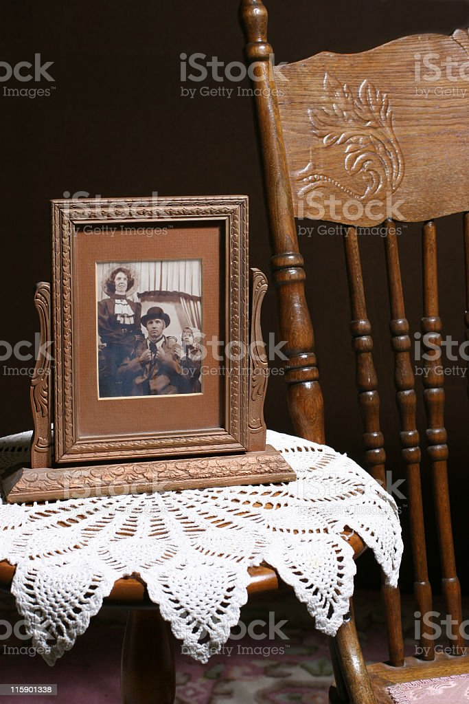 Framed vintage photograph. Old-fashioned, retro, antique. Furniture. Sepia. royalty-free stock photo