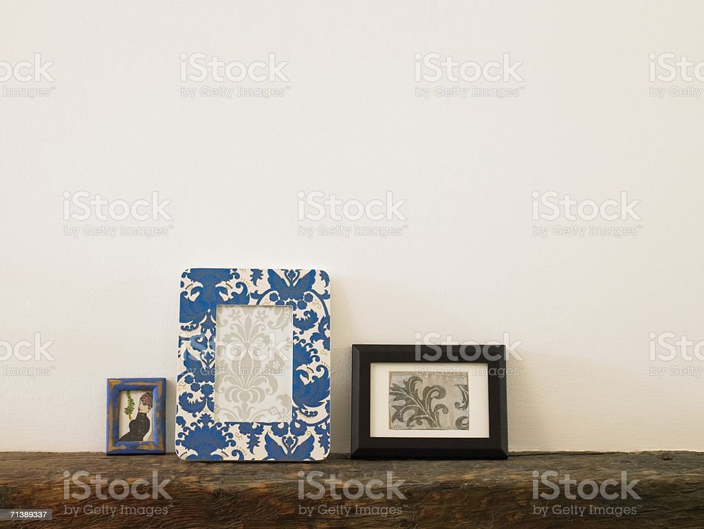 Frames on a mantelpiece stock photo
