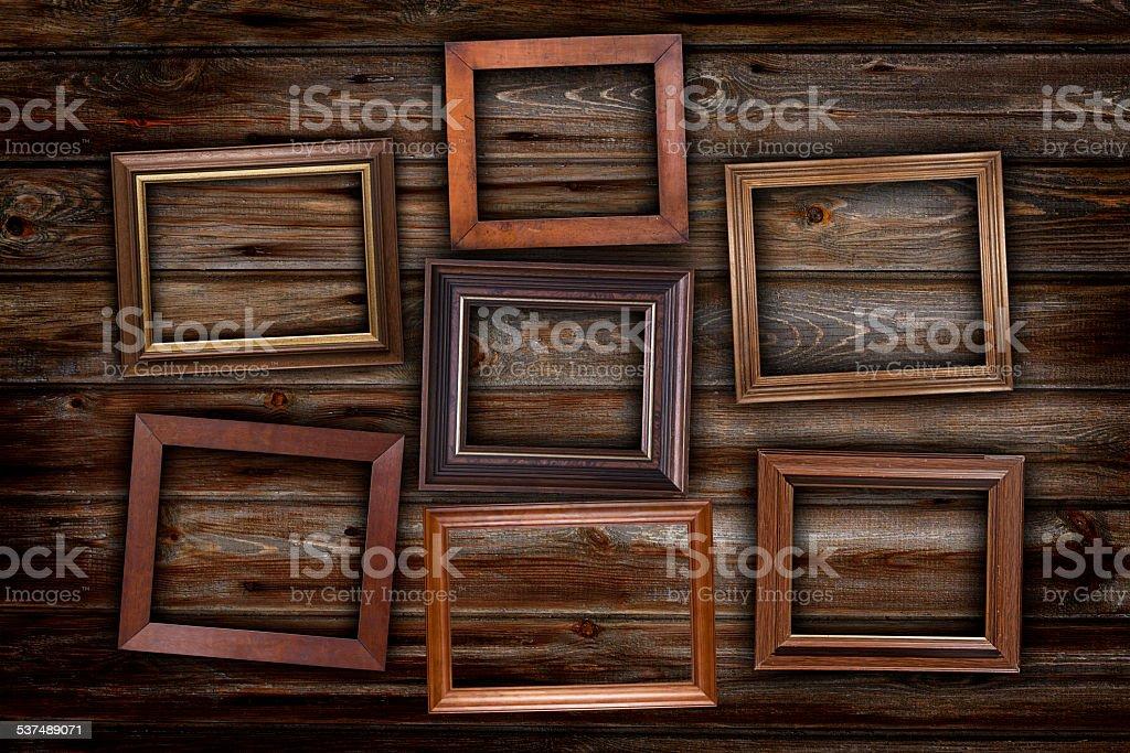 Frames on wooden planks stock photo