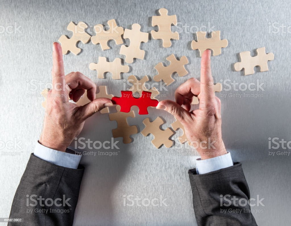 framing businessman hands picking the odd one to link others stock photo