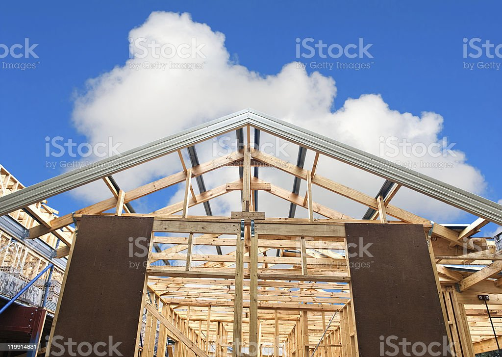 Framing for the house and roof of a new home royalty-free stock photo