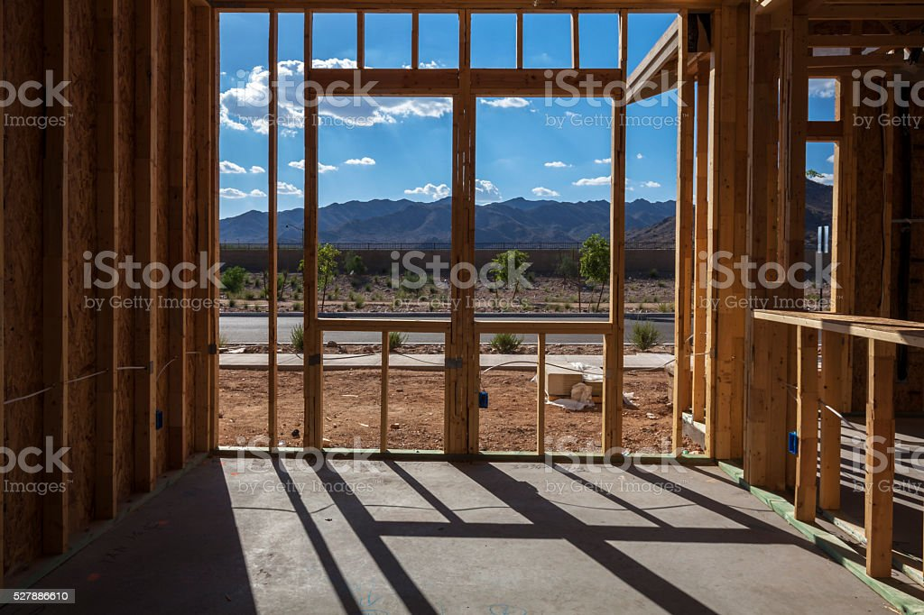 Framing of New Construction with mountains in the background stock photo