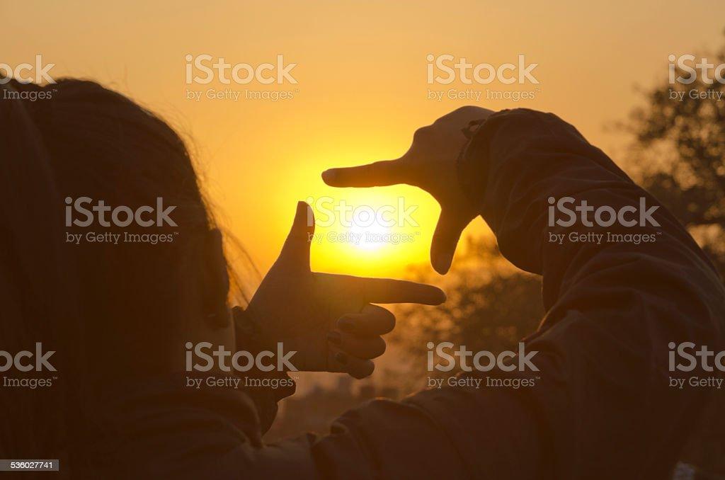 Framing the sun stock photo