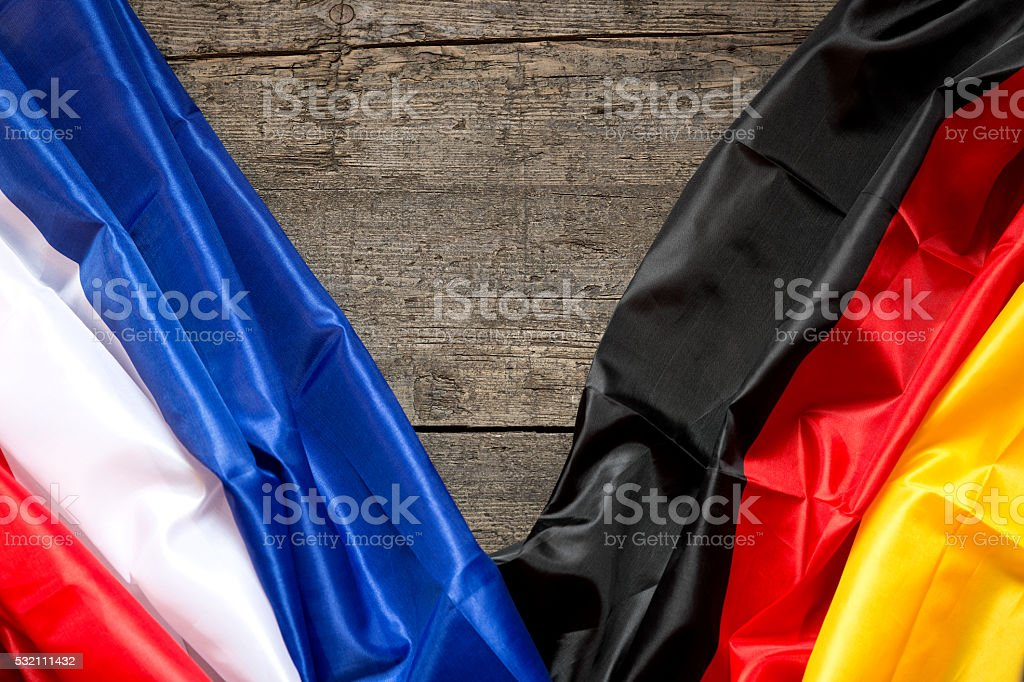 France and Germany Flag on a wooden Background stock photo