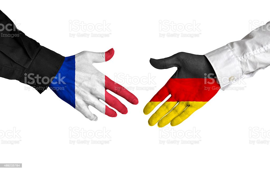 France and Germany leaders shaking hands on a deal agreement stock photo