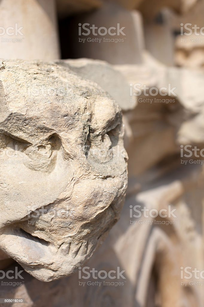 France antiquities stone wall eroded cathedral protective gargoyles closeup stock photo