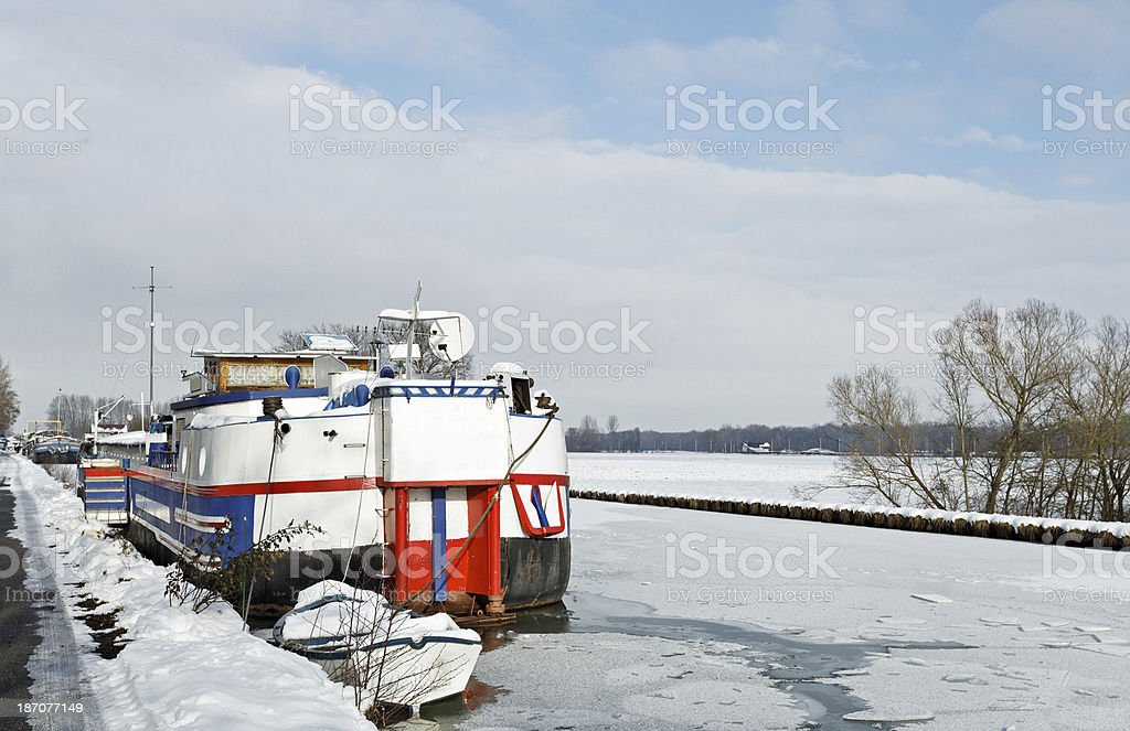 France - Barge in the frozen Marne-Rhine Canal stock photo