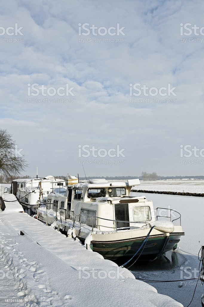 France - Boat in the frozen Marne-Rhine Canal stock photo
