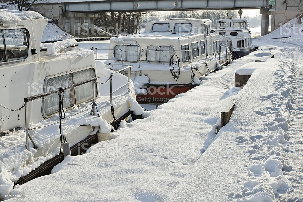 France - Boats in the frozen Marne-Rhine Canal stock photo