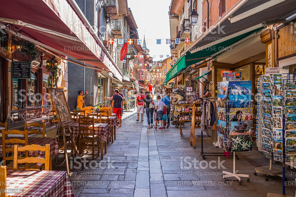 France. Bourg-Saint-Maurice, Old town: street with shops and tourists stock photo