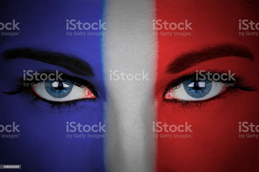 France flag painted on the face of a woman. stock photo