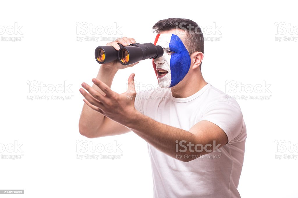 France football fan at game of national team over binoculars stock photo