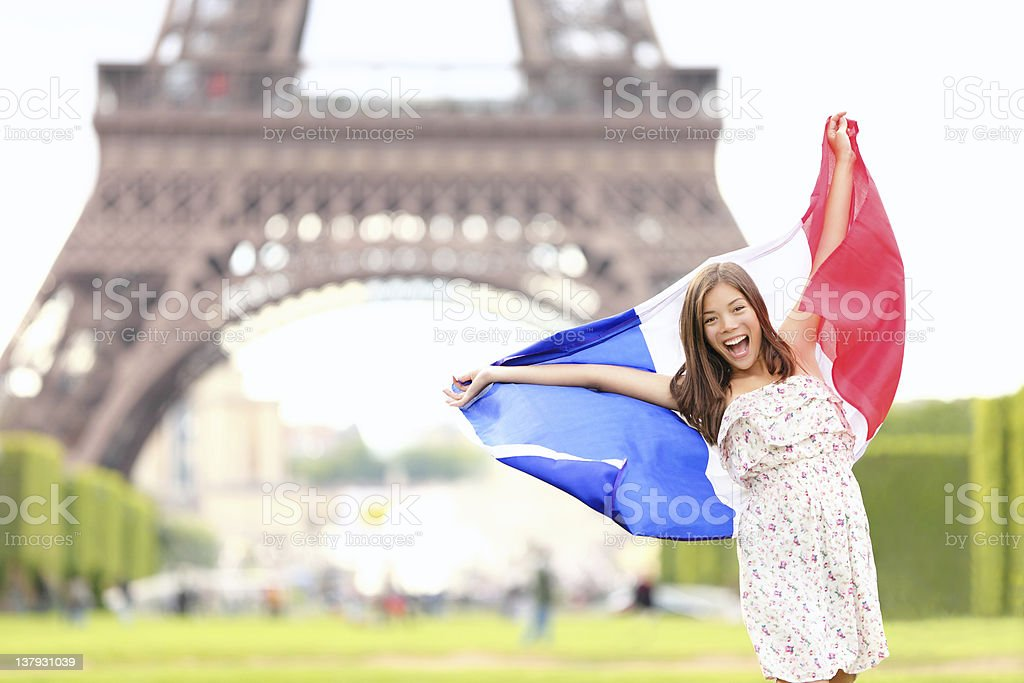 France - french flag woman by Eiffel tower, Paris royalty-free stock photo