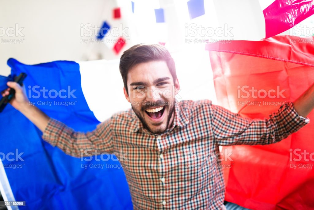 France man supporters at home screaming for the victory stock photo
