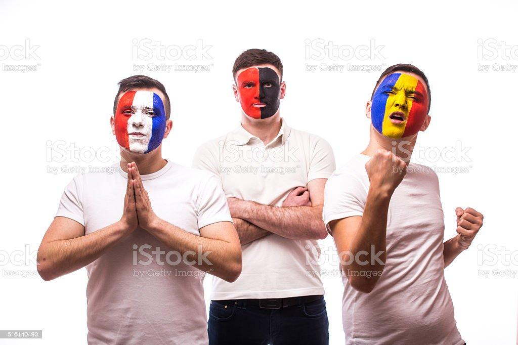 France - pray, Albania - serious, Romania – win. stock photo