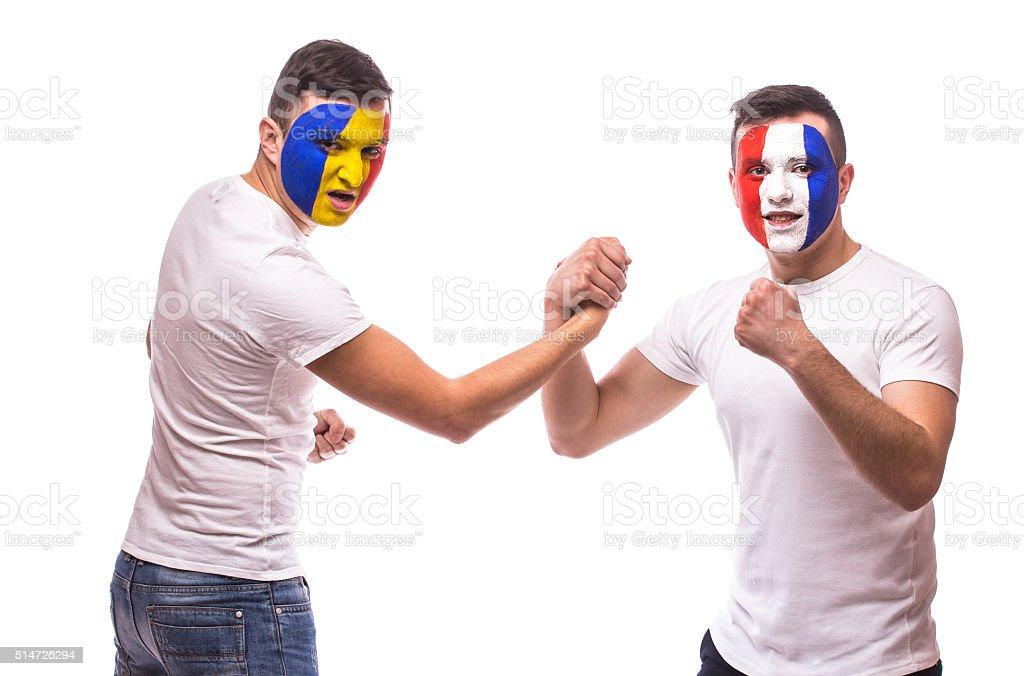 France vs Romania. Football fans of national teams friendly handshake stock photo