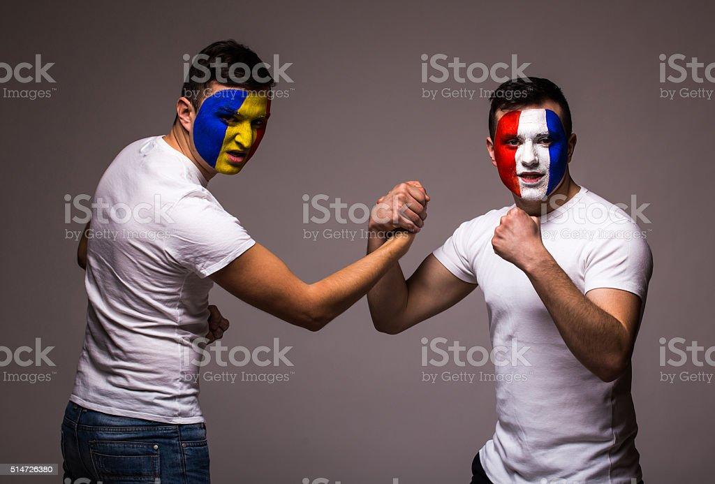 France vs Romania. Football fans of national teams handshake stock photo