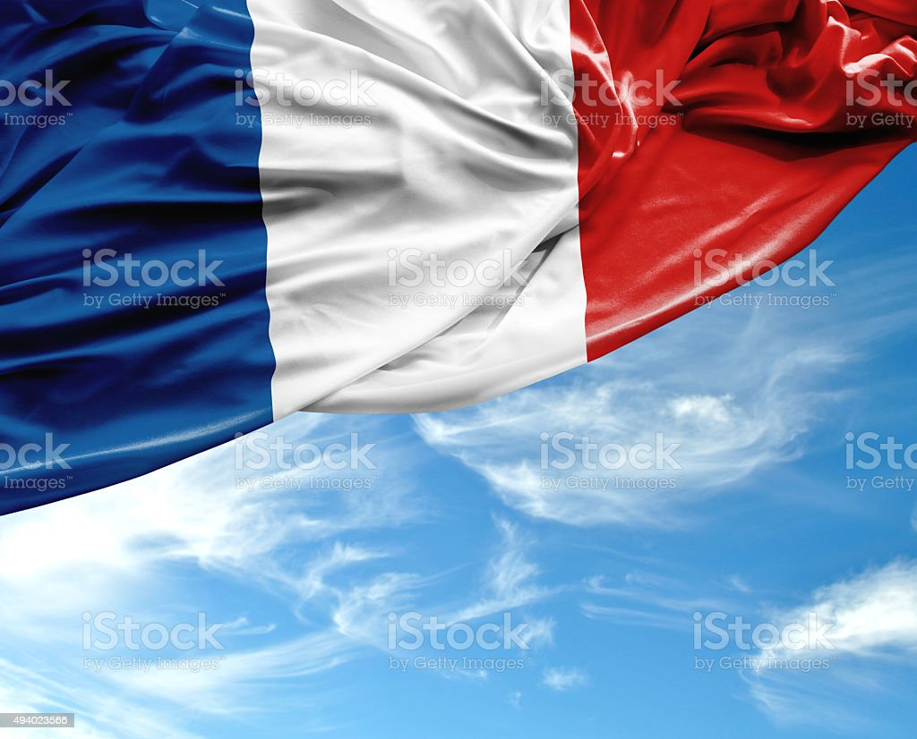 France waving flag on beautiful day stock photo