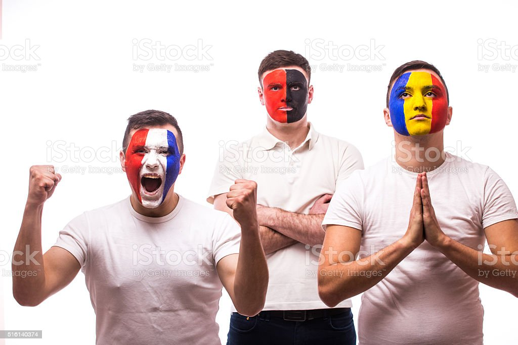 France - win, Albania - serious, Romania - pray stock photo