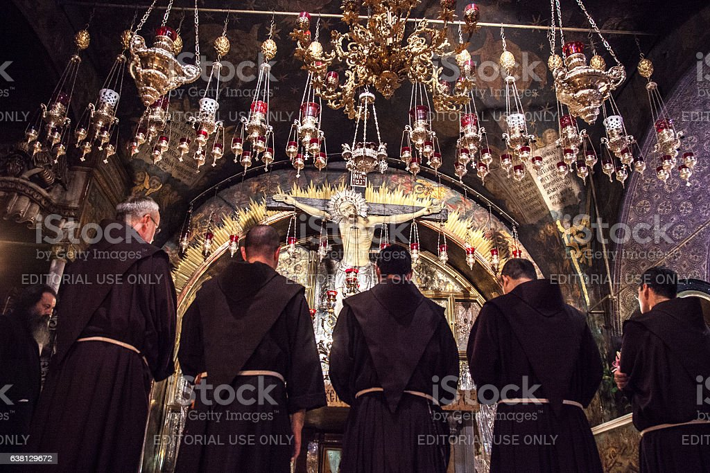Franciscan monks in Holy Sepulchre Church stock photo