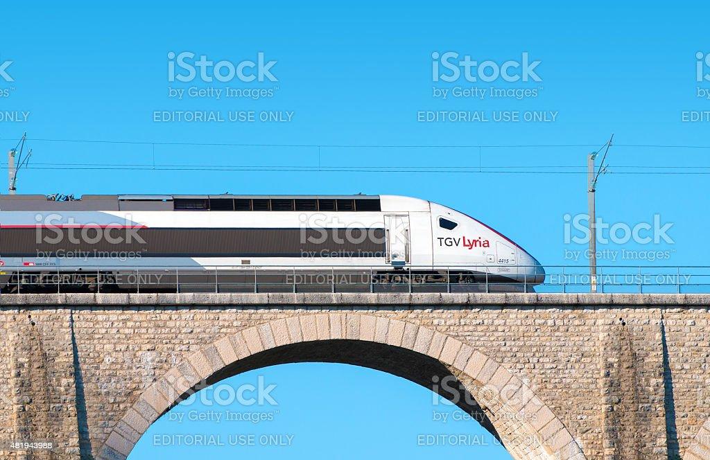 Franco Swiss TGV Lyria high speed train on stone bridge stock photo
