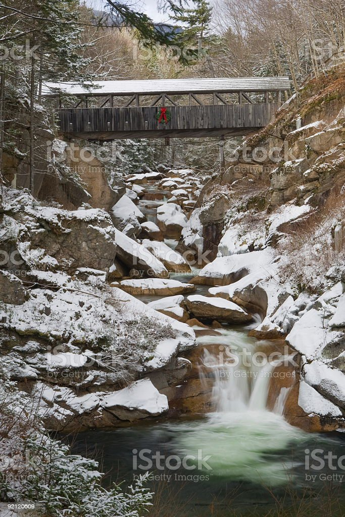 Franconia Notch Flume Series -Sentinel Pine Bridge in Early Snow royalty-free stock photo
