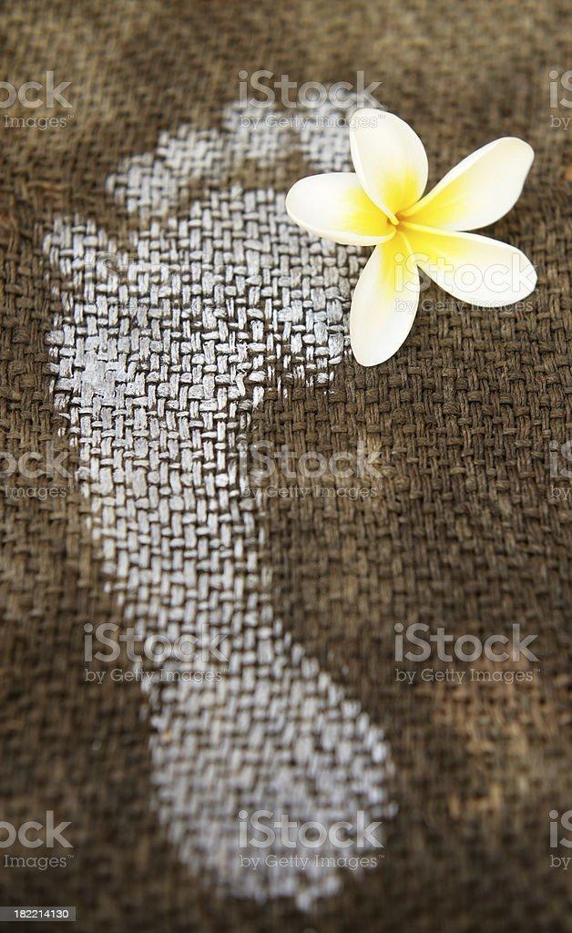 Frangipani flower and footprint royalty-free stock photo