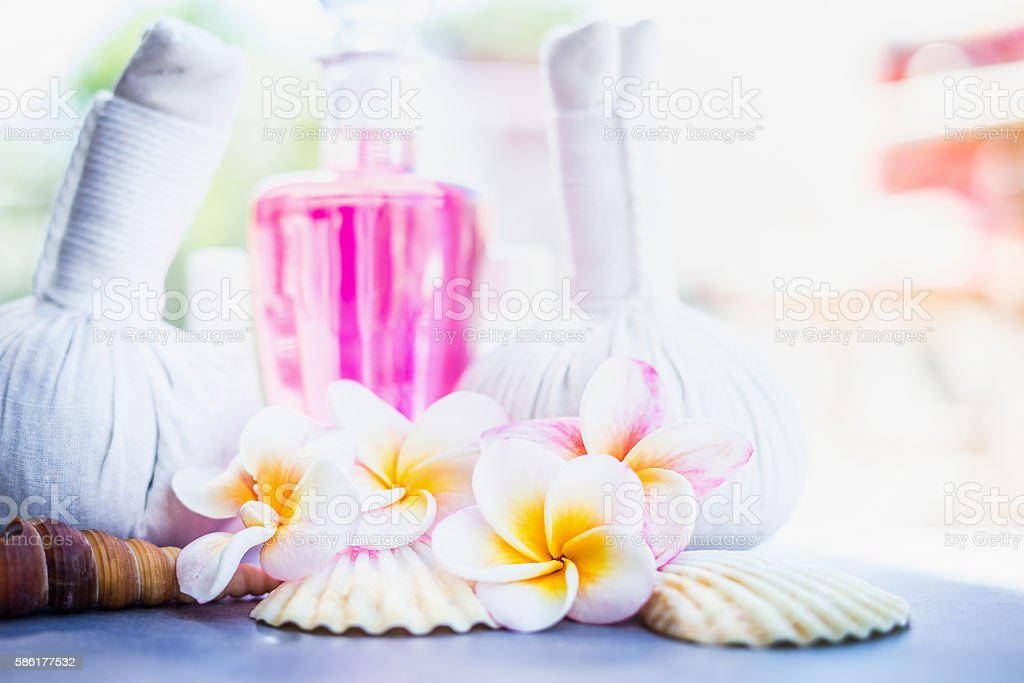 Frangipani flowers with spa massage stamps and shells stock photo