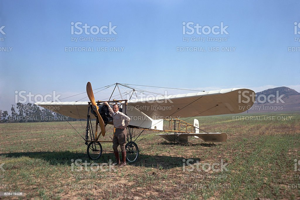 Frank Tallman and 1909 Bleriot XI airplane in field stock photo