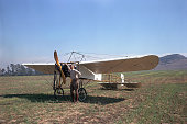Frank Tallman and 1909 Bleriot XI airplane in field