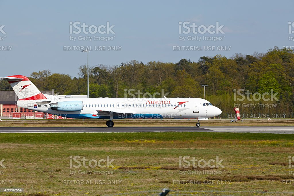 Frankfurt Airport - Fokker 100 of Austrian Airlines takes off stock photo