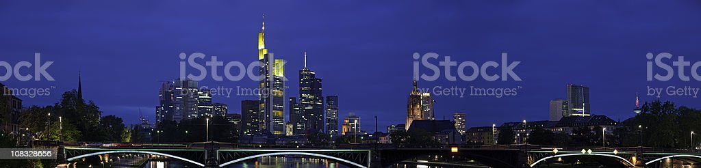 Frankfurt downtown skyscrapers banking business finance district panorama night Germany stock photo