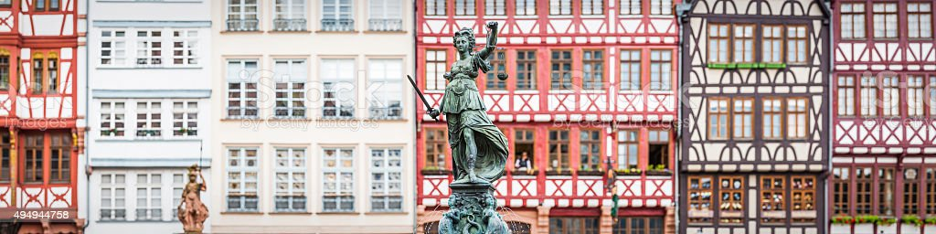 Frankfurt Fountain of Justice statue medieval Romerberg Square panorama Germany stock photo