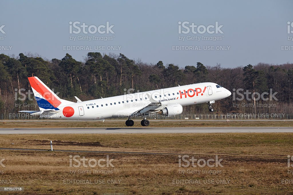 Frankfurt International Airport - HOP! Embraer 190 takes off stock photo