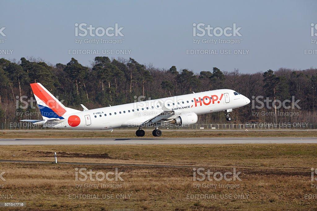 Frankfurt International Airport - HOP! Embraer 190 takes off stock photo