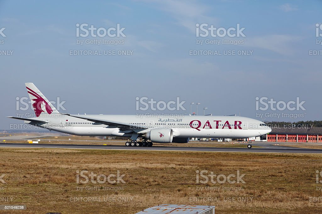 "Frankfurt International Airport -€"" Qatar Airways Boeing 777 takes off stock photo"