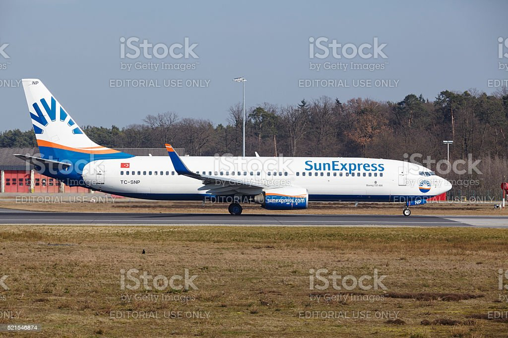 "Frankfurt International Airport -€"" SunExpress Boeing 737 takes off stock photo"