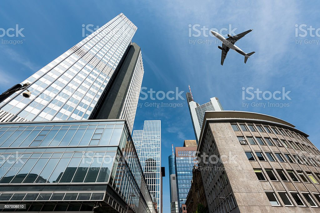 Frankfurt skyscrapers buildings and plane flying overhead at Frankfurt, Germany. stock photo